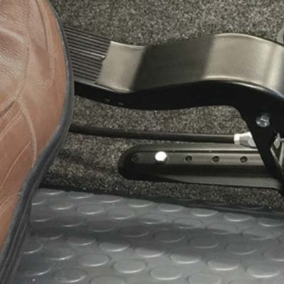 passenger foot operated dual brake pedal system